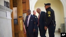 FILE - Bill Cosby, second from right, arrives at the Montgomery County Courthouse for his sexual assault trial, June 7, 2017.