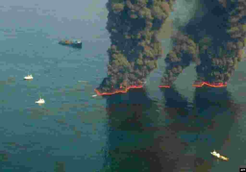 This US Coast Guard handout image shows crews conducting overflights of controlled burns taking place in the Gulf of Mexico, 19 May 2010. (AFP Image)