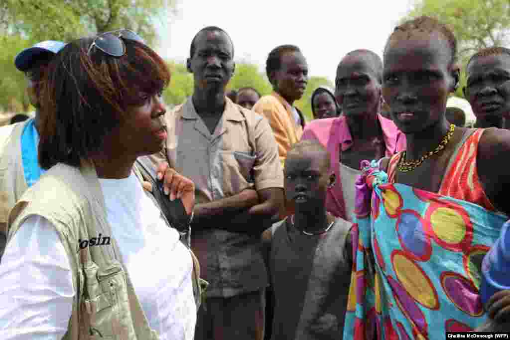 World Food Program Executive Director Ertharin Cousin (L) meets with displaced South Sudanese during a three-day visit to the country.