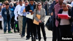 FILE - People wait in line to enter the Nassau County Mega Job Fair at Nassau Veterans Memorial Coliseum in Uniondale, N.Y., Oct. 7, 2014.