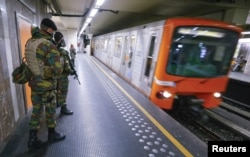 FILE - Belgian soldiers patrol in a subway station in Brussels, Nov. 25, 2015. Brussels' metro re-opened on Wednesday after staying closed for four days following tight security measures linked to the fatal attacks in Paris.