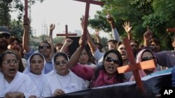 Pakistani Christians chant slogans to condemn the killing of a Christian couple during a demonstration in Lahore, Pakistan, Nov. 5, 2014.