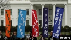 FILE - Opponents of the Trans Pacific Partnership trade agreement protest outside the White House in Washington, Feb. 3, 2016.