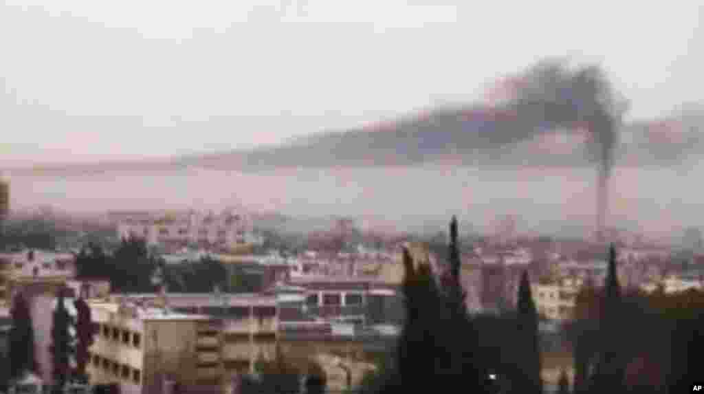 This image from amateur video purports to show smoke rising in Homs, Syria, February 16, 2012. (AP / Shaam)