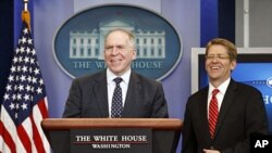 John Brennan (L), assistant to the president for homeland security and counterterrorism, and White House Press Secretary Jay Carney smile as they take the rostrum to speak about the killing of Osama bin Laden at the White House, Washington May 2, 2011