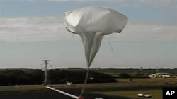High-altitude balloon carrying saucer-shaped vehicle for NASA is launched to test technology that could be used to land on Mars. (Hawaii, June 2014)
