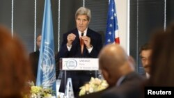 U.S. Secretary of State John Kerry gestures as he delivers a speech to UNESCO Ambassadors and Permanent Delegates at the UNESCO headquarter in Paris, Oct. 18, 2015.