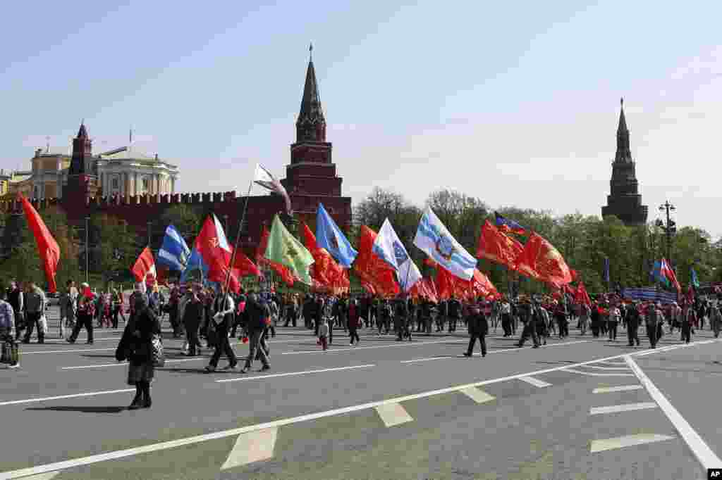 Thousands of Communists march along Kremlin Towers during May Day demonstration in downtown Moscow, May, 1, 2014.