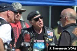 Rolling Thunder Executive Director Artie Muller is seen with fellow motorcyclists at the Pentagon, in Arlington, Virginia, outside of Washington, May 26, 2019.