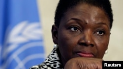FILE - Valerie Amos, Under-Secretary-General and Emergency Relief Coordinator at the United Nations Office for the Coordination of Humanitarian Affairs, pauses during a news conference at UN headquarters in Geneva on February 19, 2013.