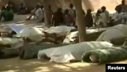Gawarwakin mutanen da 'Yan Boko Haram suka kashe a Konduga, Jihar Borno, Fabrairu 12, 2014.