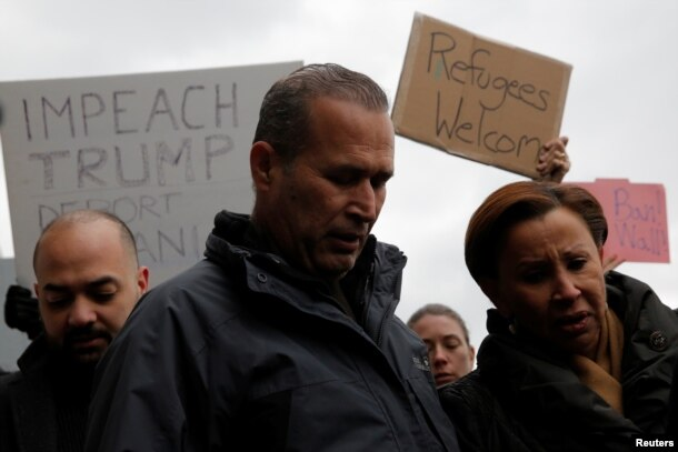 Iraqi immigrant Hameed Khalid Darweesh stands with Congresswoman Nydia Velazquez, right, after being released at John F. Kennedy International Airport in New York, Jan, 28, 2017.