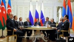 Russia then-President Dmitry Medvedev, center, Armenian President Serge Sarkisian, second right, and Azerbaijan's President Ilham Aliyev, second left, meet in the presidential palace of the Kremlin in Kazan, Russia, Friday, June 24, 2011.