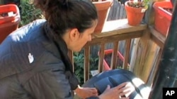 Once a day, Christiana Aretta spins the compost bin on her small apartment porch in Washington, D.C..