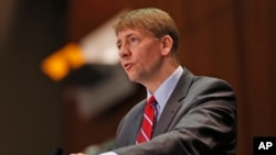 "FILE - Consumer Financial Protection Bureau Director Richard Cordray, pictured in March 2015, says arbitration clauses in consumers' agreements with financial companies effectively deny groups ""the right to seek justice and relief for wrongdoing."""