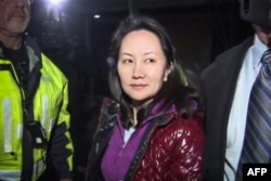 FILE - Huawei Technologies Chief Financial Officer Meng Wanzhou is seen as she exits the court registry following a bail hearing at British Columbia Superior Courts in Vancouver, British Columbia, Dec. 11, 2018.