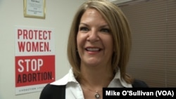 Trump supporter Dr. Kelli Ward is running for the U.S. Senate, from a small office in Phoenix, Arizona, Feb 19, 2017. She looks to Trump to reverse the ACA, to cut taxes and to make more cautious use of the U.S. military.