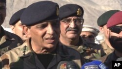 Pakistan's army chief Gen. Ashfaq Parvez Kayani talks with reporters after visiting the Siachen Glacier, where a huge avalanche buried some 140 people, April 18, 2012.