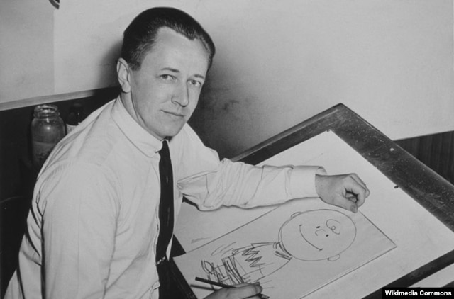 "Charles Schulz in 1956 with his ""Peanuts"" creation, Charlie Brown"
