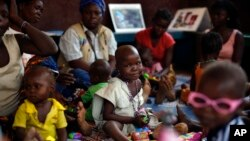FILE - Children recovering from malnutrition play at the Children hospital in Bangui, Central African Republic.