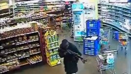 FILE - A gunman aims his rifle inside a store during an attack on the Westgate shopping mall, released to Reuters Oct. 17, 2013.