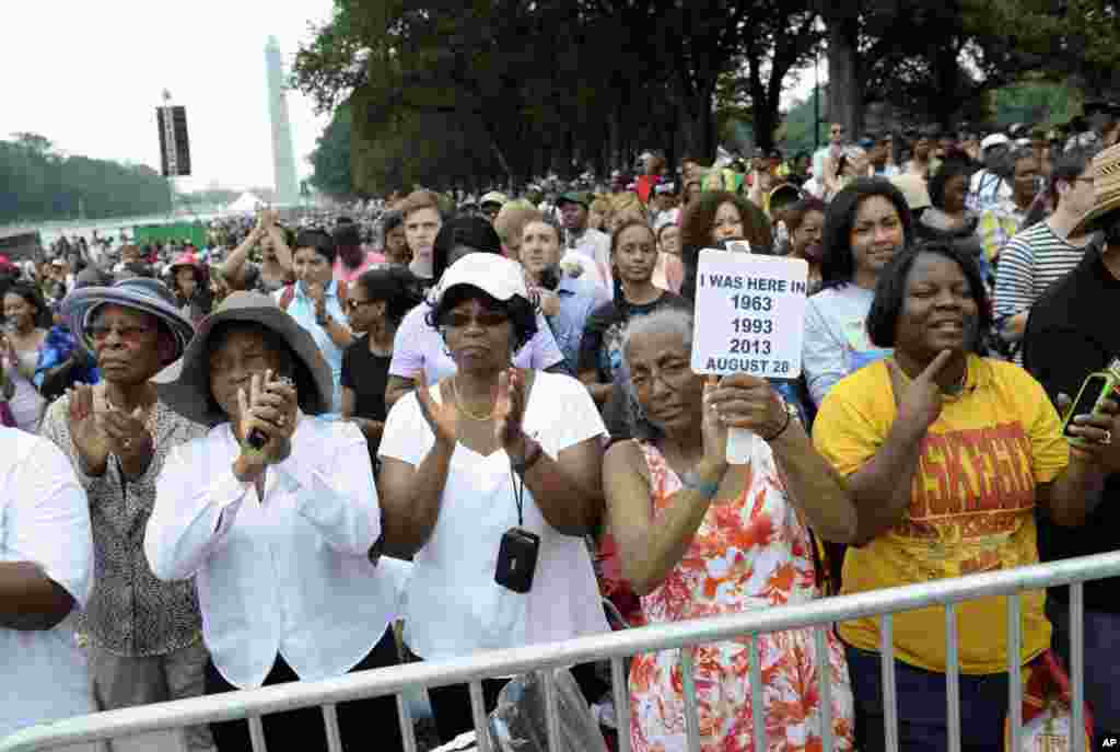 Three women who attended marches in the past, from left, Armanda Hawkins of Memphis, Vera Moore of Washington, and Betty Waller Gray of Richmond, Va., (holding sign) listen to the speakers during the March on Washington, Aug. 28, 2013, at the Lincoln Memorial.