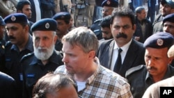Pakistani police escort arrested U.S. national, identified as Raymond Davis (C), to a court in Lahore, January 28, 2011.