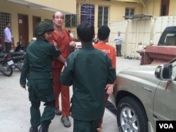 FILE - Australian filmmaker James Ricketson, who is accused of espionage, appears at the Supreme Court in Phnom Penh, Jan. 17, 2018.