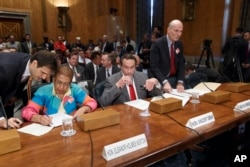 FILE - From left, Delegate Eleanor Holmes Norton, the District of Columbia's nonvoting delegate in the U.S. House; then-D.C. Mayor Vincent C. Gray; and D.C. Council Chairman Philip H. Mendelson, prepare to testify before a Senate panel on a D.C. statehood bill, Sept. 15, 2014.