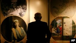 A man attends the launch of the World Digital Library in Paris, Tuesday April 21, 2009.