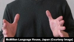 """Using your hands to demonstrate the topic you are delivering is seen as good public speaking. This screenshot is from """"Speaking of Speech"""" by David Harrington and Charles LeBeau."""