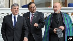 Turkish President Abdullah Gul, left, his Afghan counterpart Hamid Karzai, right, and President Asif Ali Zardari of Palistan walk after a meeting in Istanbul, Turkey. Turkey is hosting a conference this week on creating a regional strategy for improving s