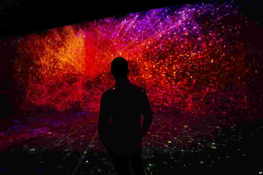 A visitor watches a projection at the TelcoDR booth during the Mobile World Congress 2021 in Barcelona, Spain.