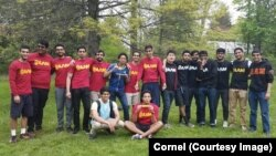 Members of Cornell University's Alpha Lambda Mu fraternity gather for an end-of-year barbecue at the college's New York campus.