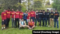Members of Cornell University's Alpha Lambda Mu fraternity gather for an end-of- school year barbecue at the college's New York campus.