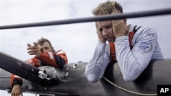 Skipper Ken Read from the USA, right, reacts to a broken mast on the first leg of the Volvo Ocean Race, Nov. 21, 2011.
