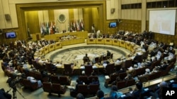 FILE - Representatives of Arab League countries are seen meeting at the group's headquarters in Cairo, Egypt.