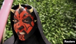 "A woman dressed as the character Darth Maul attends the rollout of products in advancement of the film ""Star Wars: The Force Awakens"" on ""Force Friday"" in Sao Paulo, Brazil, Sept. 4, 2015."