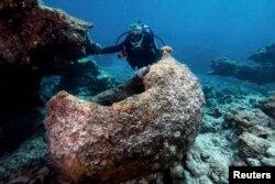 FILE - Maritime archaeologist Kelly Gleason with the Papahanaumokuakea Marine National Monument.