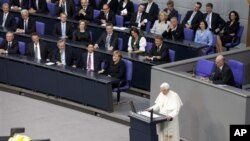 German Chancellor Angela Merkel, center left, and her government listen to Pope Benedict XVI, center, as he delivers his speech at the German parliament Bundestag in Berlin, Germany, Sept. 22, 2011.