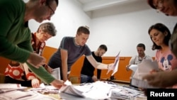 Election Commission officials count votes in the central Bosnian town of Zenica Oct. 12, 2014.