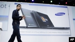 Sundar Pichai, VP of Product Management for Google, displays a Samsung notebook running on the Chrome operating system at the Google IO Developers Conference in San Francisco, May 11, 2011.
