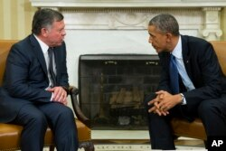 President Barack Obama, right, meets with King Abdullah II of Jordan in the Oval Office of the White House, Feb. 3, 2015, in Washington.