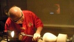 Wood turner Eliot Feldman uses a lathe to shape a block of wood into a drinking vessel