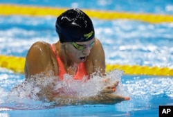 Russia's Yulia Efimova competes in a women's 100-breaststroke heat during the swimming competitions at the 2016 Summer Olympics in Rio de Janeiro, Brazil, Aug. 7, 2016.