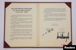 A document signed by U.S. President Donald Trump and North Korea's leader Kim Jong Un is seen in Singapore in this picture released on June 12, 2018 by North Korea's Korean Central News Agency.