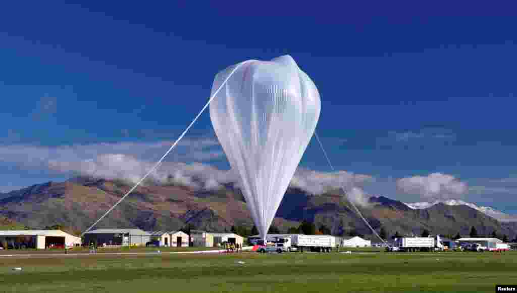 A NASA super pressure balloon is prepared for launch from Wanaka Airport on New Zealand's South Island in this image provided by NASA.