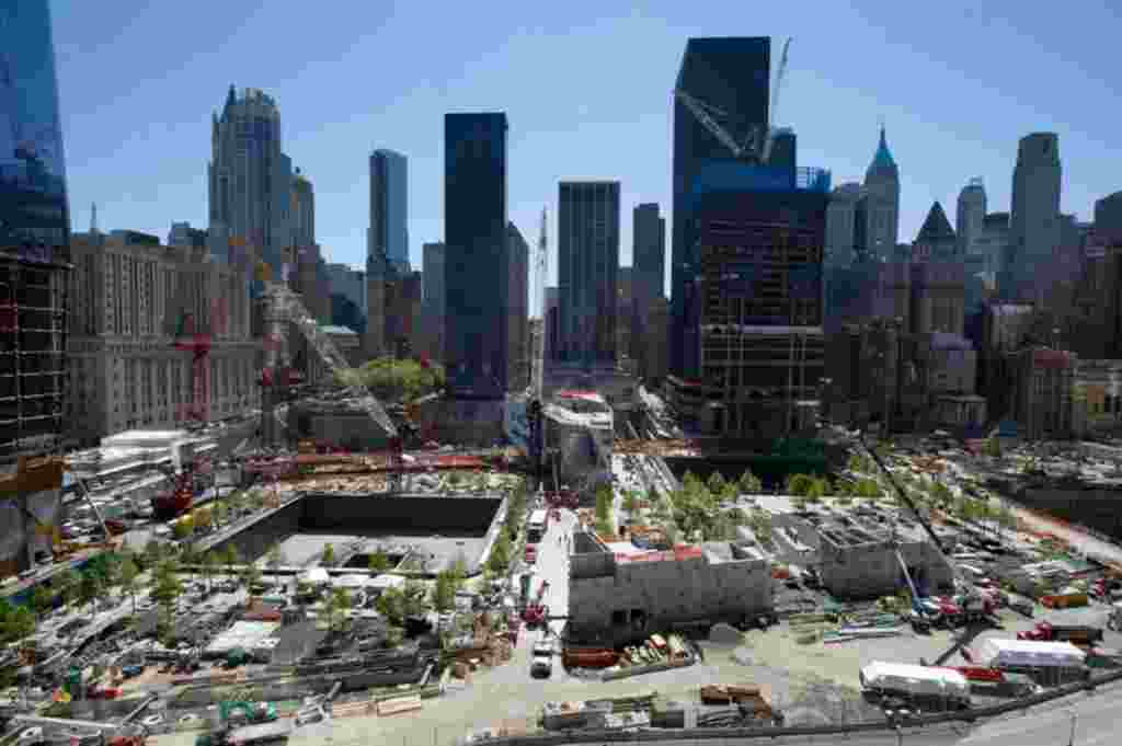 May 10: The memorial for victims of the 9-11 attacks at the site of the World Trade Center nears completion in New York. The two depressions mark the location of the original towers and will be reflecting pools. (REUTERS/Ray Stubblebine)