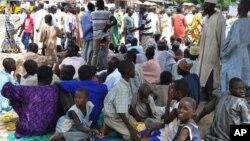 Wasu da suka tsere daga hare haren 'yan Boko Haram.