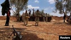 Des soldats syriens lors d'une offensive contre le groupe Etat Islamique à Dara'a